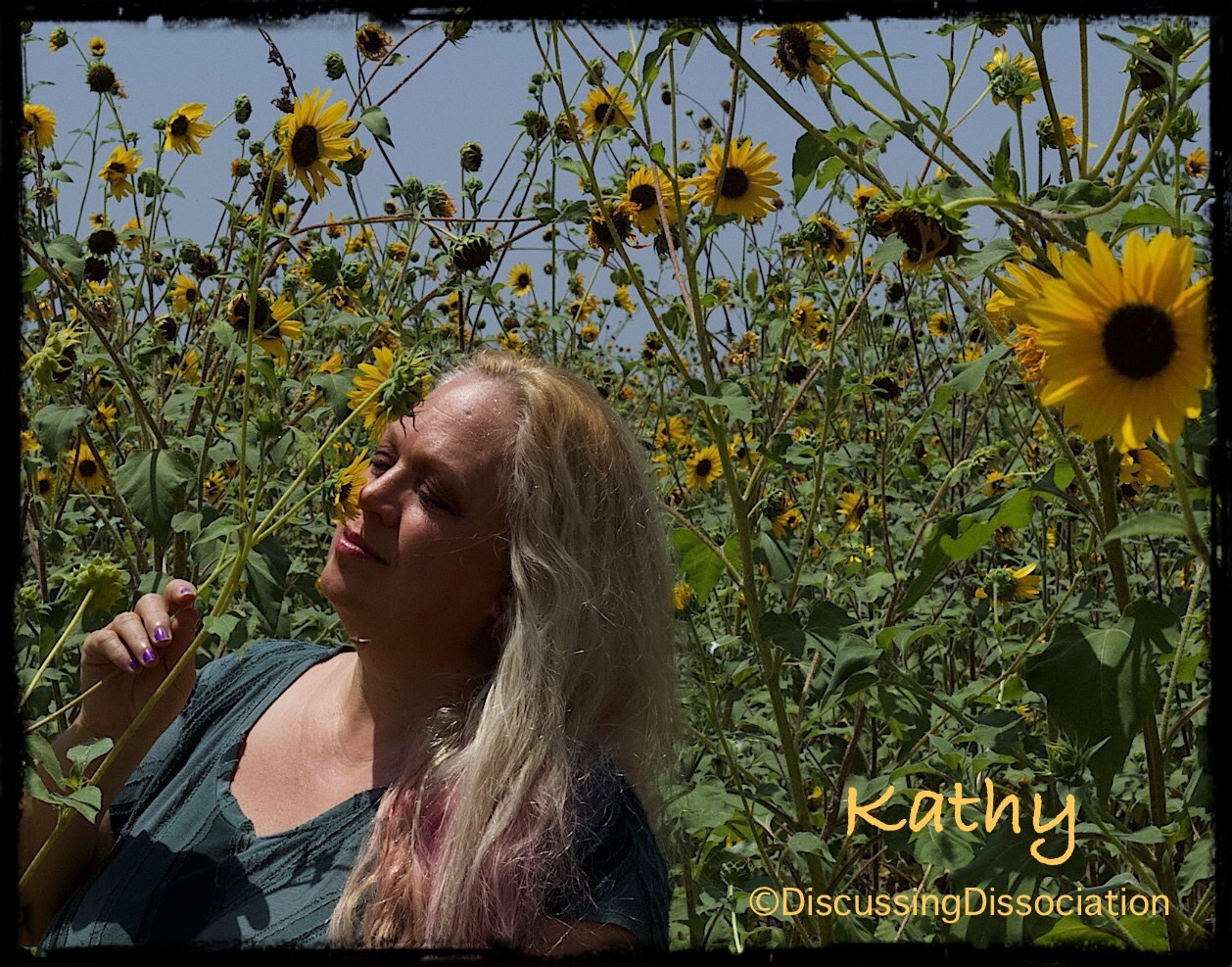 Kathy looking at sunflowers